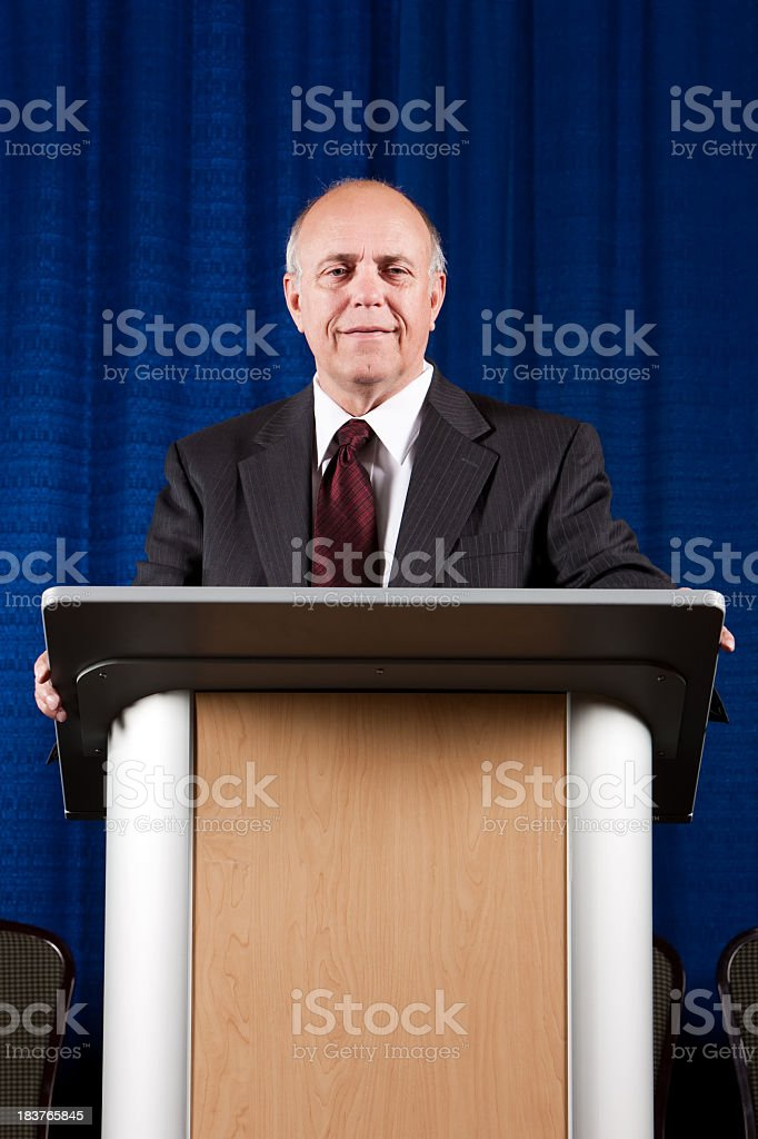 Senior Man at Podium Smiling stock photo