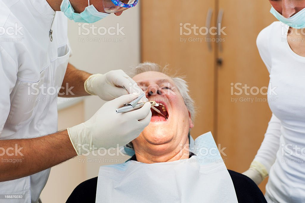 Senior man at the dentist,team working royalty-free stock photo