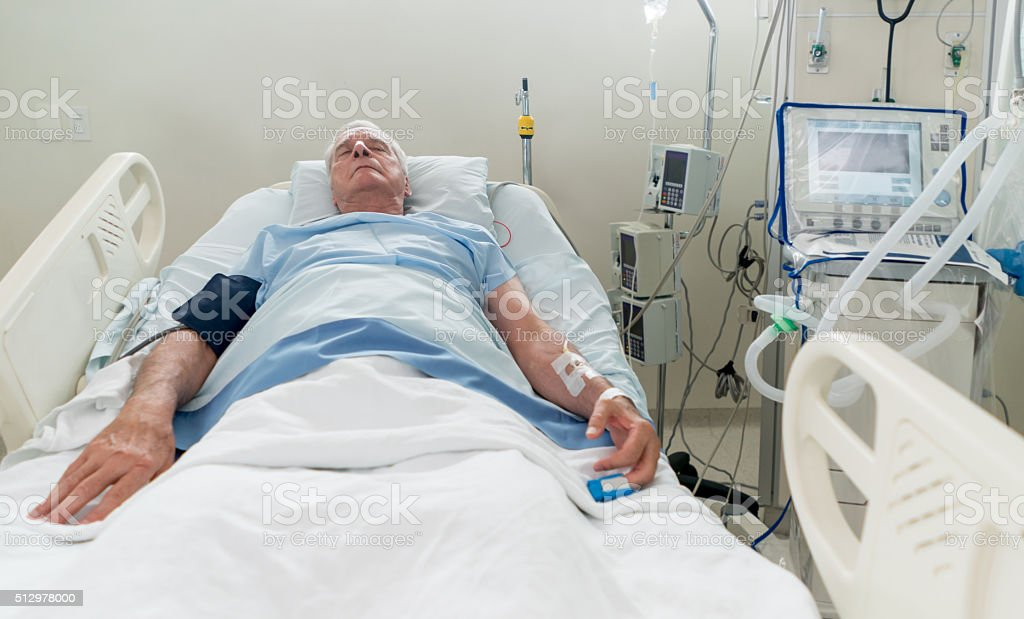 Senior man at the Intensive Care Unit stock photo