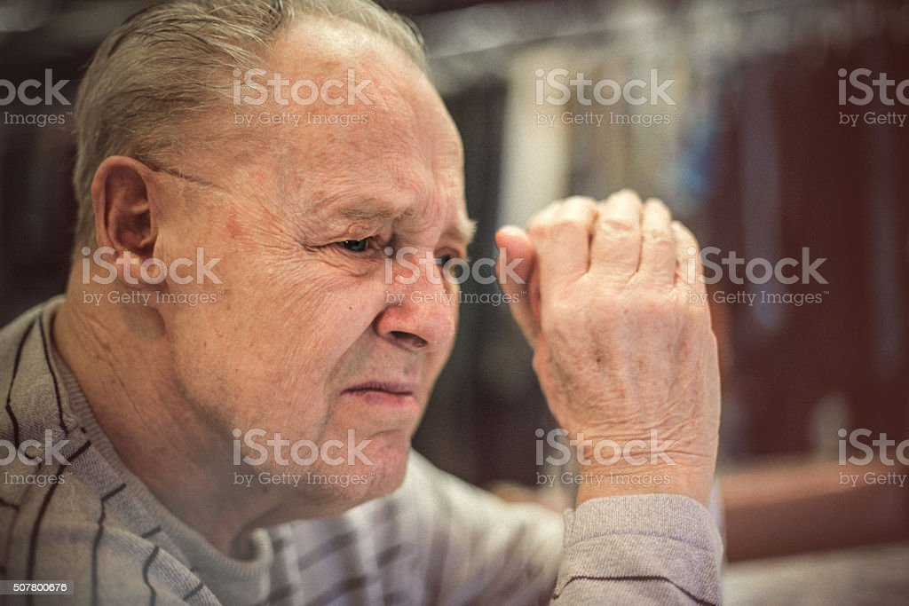Senior man battling with Alzheimer stock photo