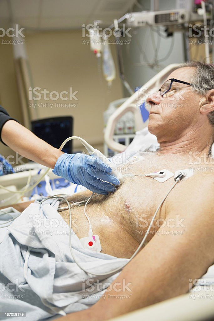 Senior man being examined in intensive care unit royalty-free stock photo