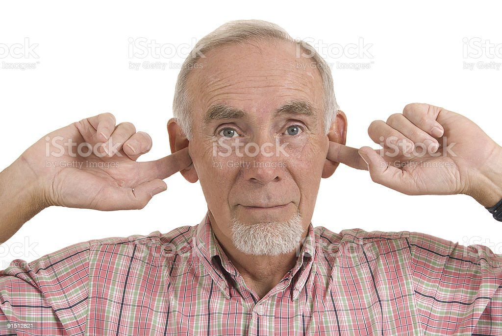 Senior man blocking ears stock photo