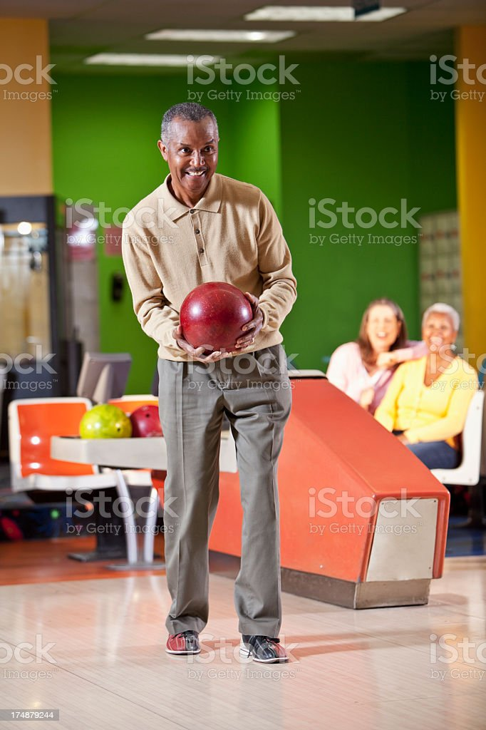 Senior man bowling stock photo