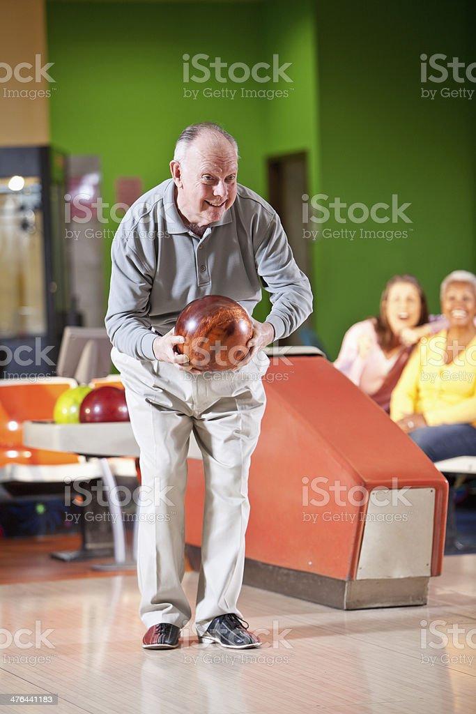 Senior man bowling stock photo
