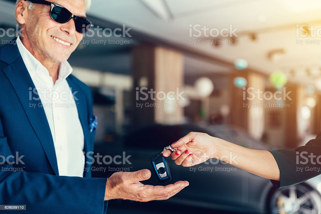 Senior man buying a new car stock photo