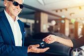 Senior man buying a new car