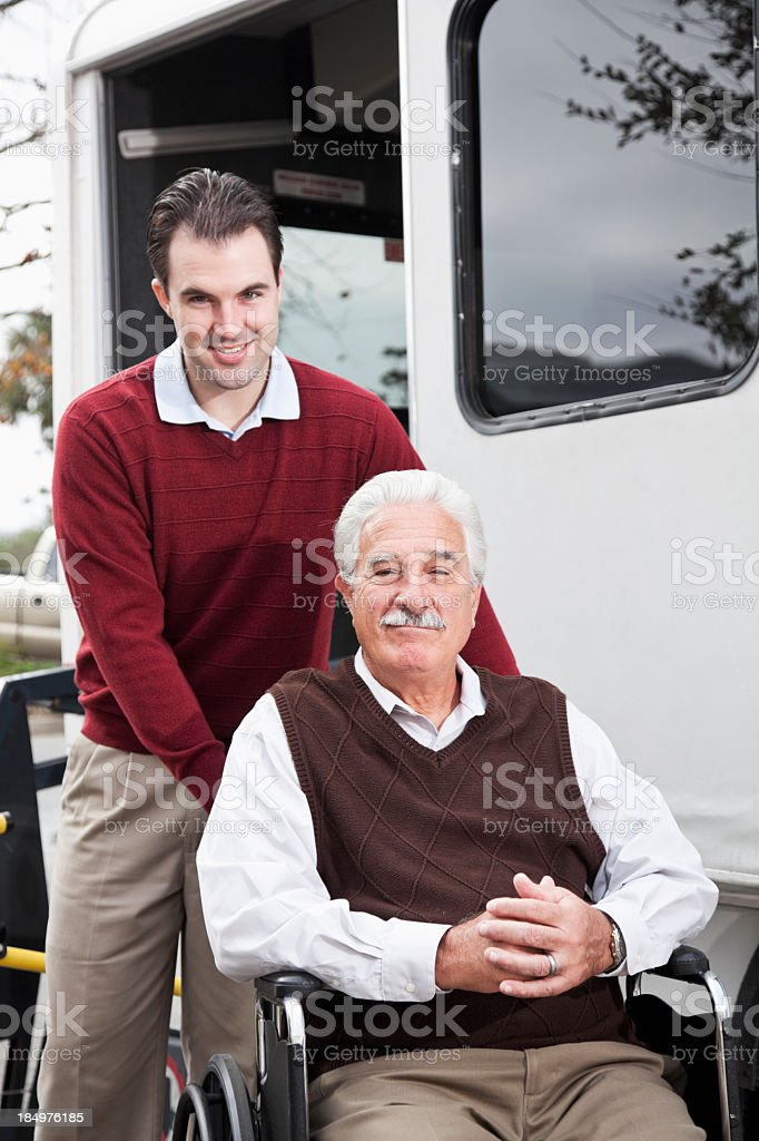 Senior man by minibus with wheelchair lift royalty-free stock photo