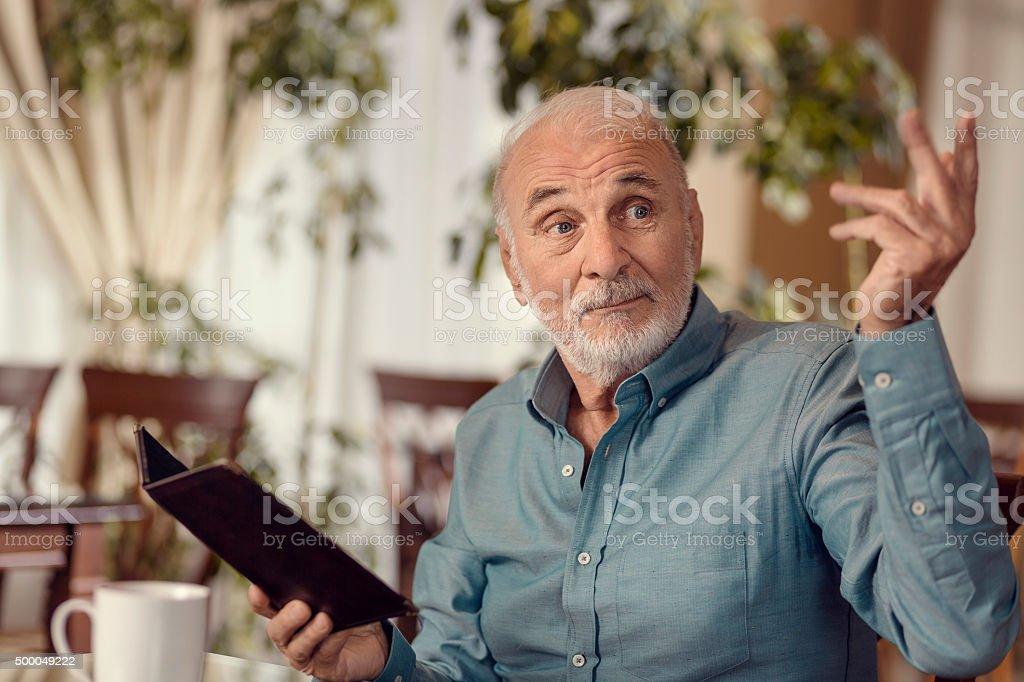 Senior Man Calling A Waiter stock photo