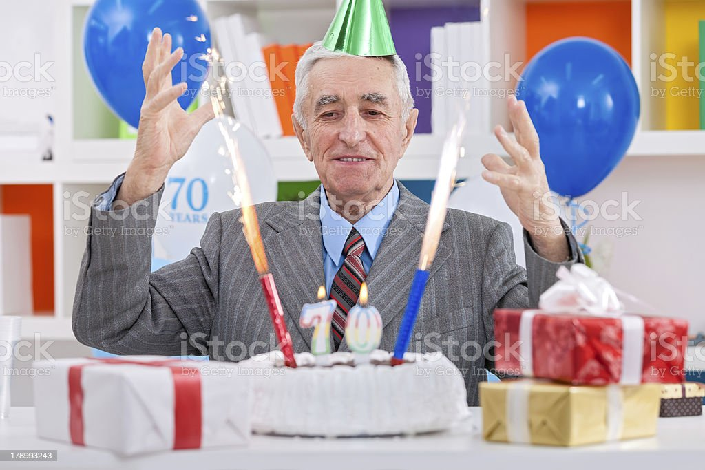 senior man celebrating 70th birthday royalty-free stock photo
