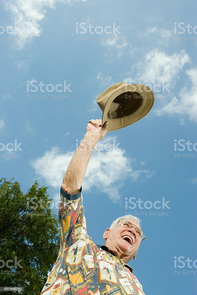 Senior man celebrating stock photo