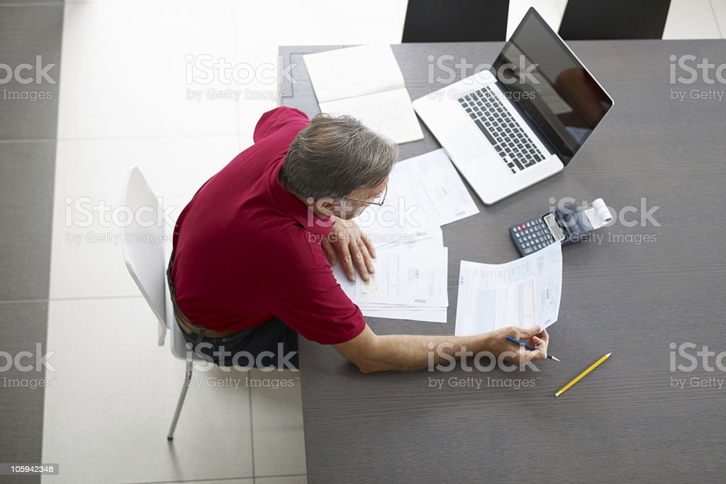 Senior man checking home finances royalty-free stock photo