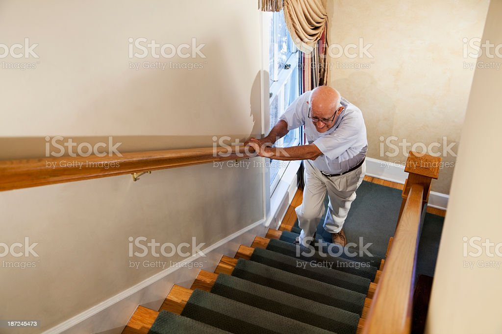 Senior man climbing stairs royalty-free stock photo
