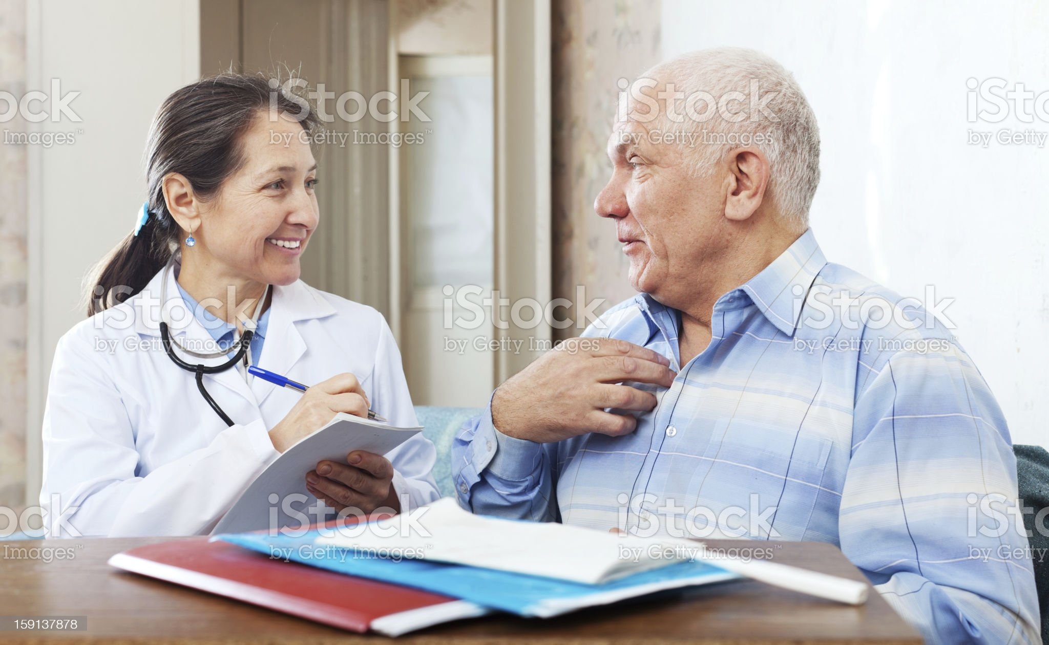 senior man  complaining to friendly doctor royalty-free stock photo