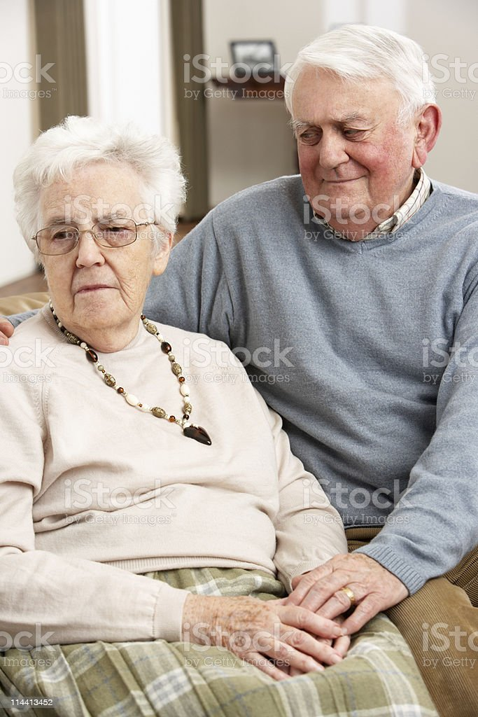 Senior Man Consoling Wife At Home royalty-free stock photo