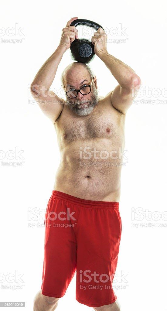 senior man dangerous kettle bell weight lifting stock photo, Muscles
