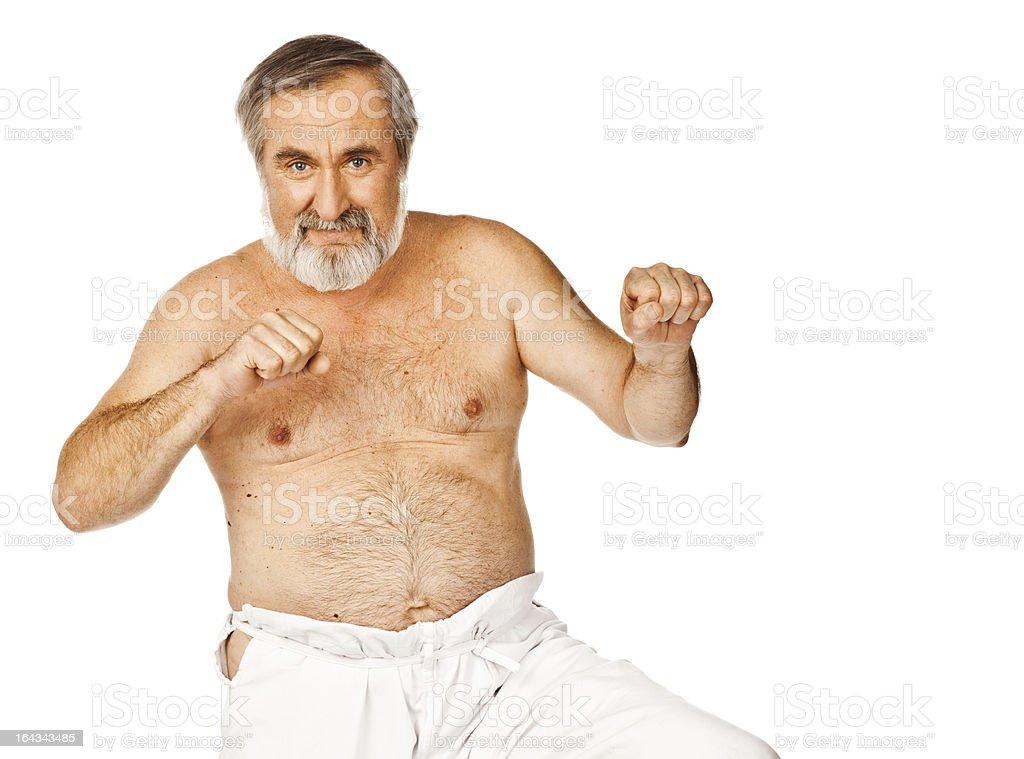 Senior man defending himself royalty-free stock photo