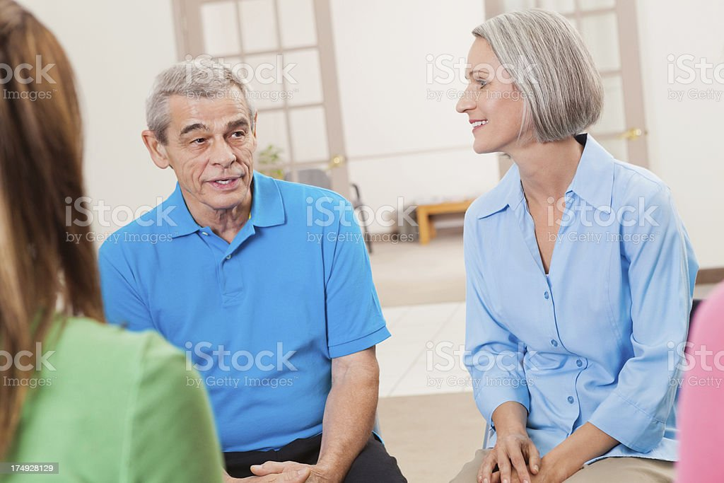 Senior man discussing serious topic with support group during meeting royalty-free stock photo
