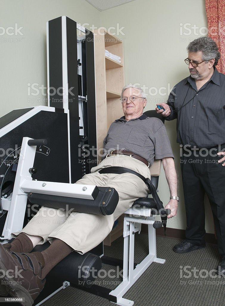 Senior Man Doing Leg Exercise - Physical Therapy Series stock photo