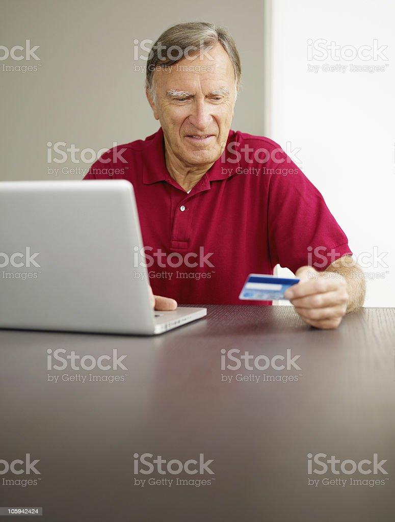 senior man doing online shopping royalty-free stock photo