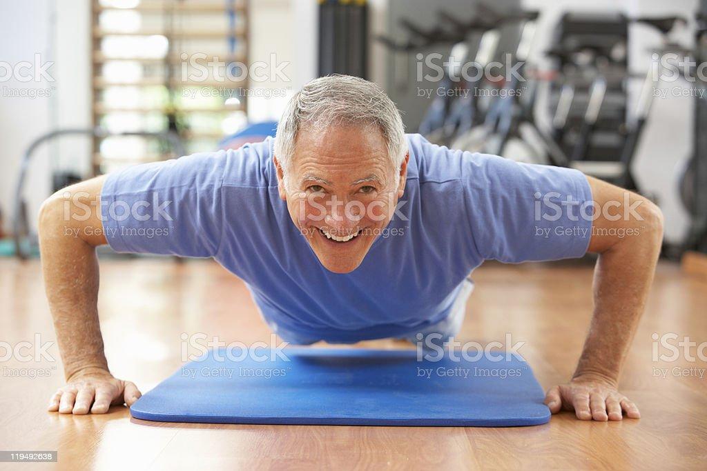 Senior Man Doing Press Ups In Gym royalty-free stock photo