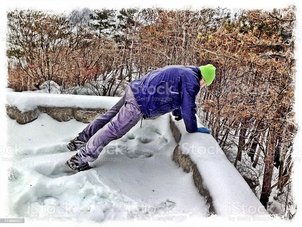 Senior Man Doing Pushups in Snow Slovenia royalty-free stock photo