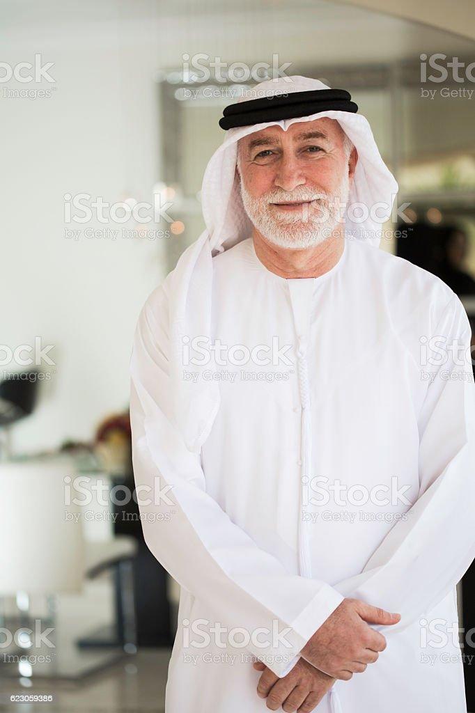 Senior man dressed in traditional dishdasha. stock photo