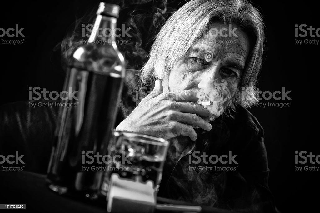 senior man drinking hard royalty-free stock photo