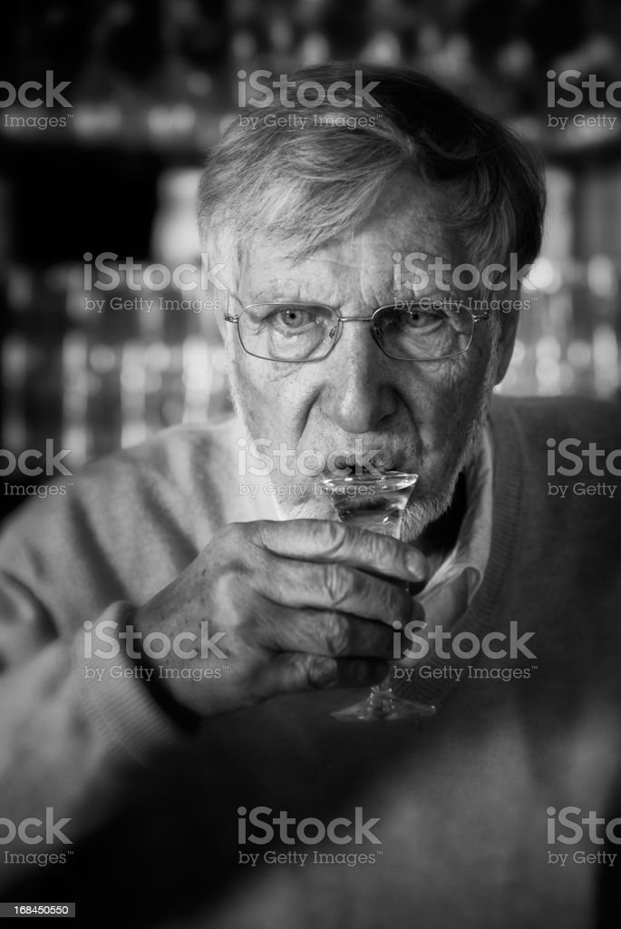 Senior man drinking Jenever stock photo