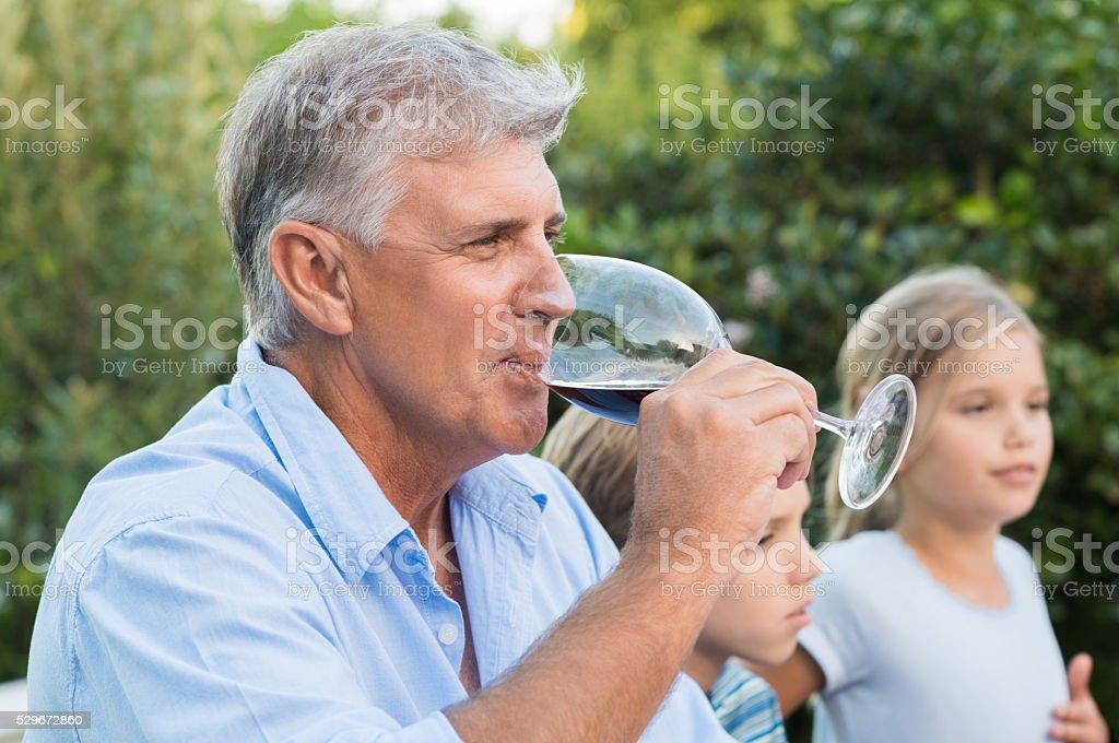 Senior man drinking wine stock photo