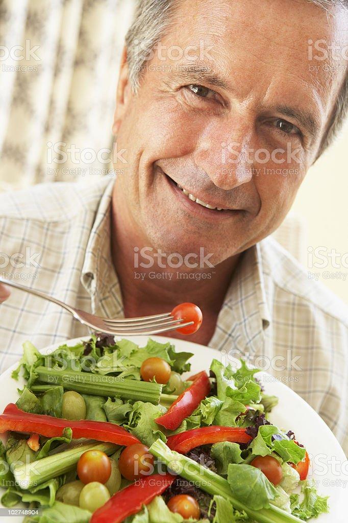 Senior Man Eating A Healthy Salad royalty-free stock photo