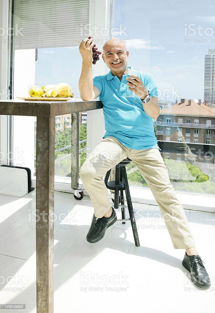 Senior man eating fruit royalty-free stock photo