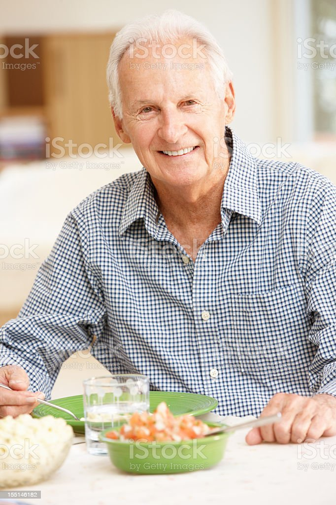 Senior man eating meal royalty-free stock photo
