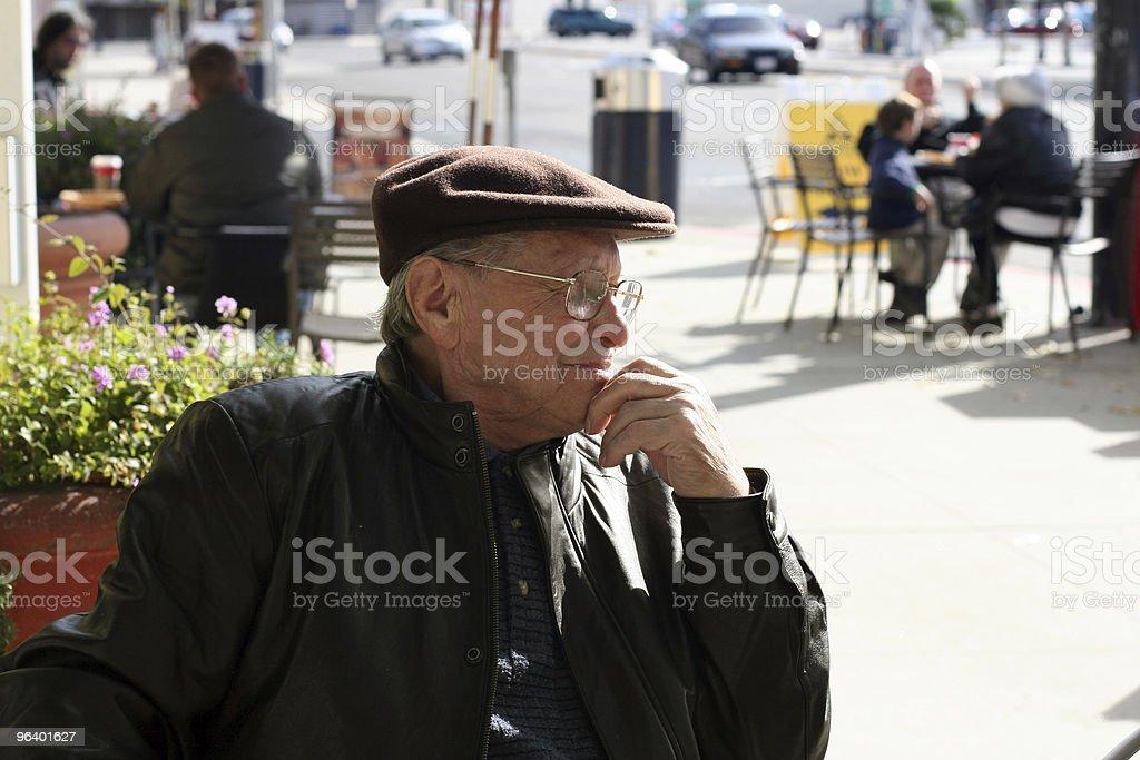 Senior man enjoying a sunny day in the city royalty-free stock photo