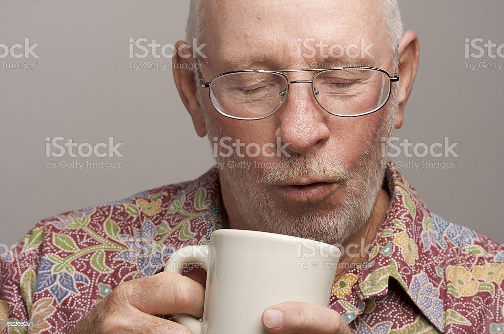 Senior Man Enjoys His Coffee stock photo