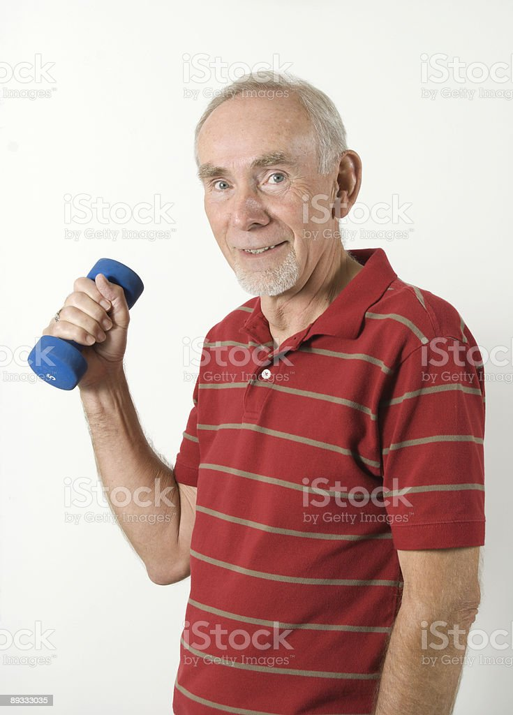 Senior man exercising with weight stock photo
