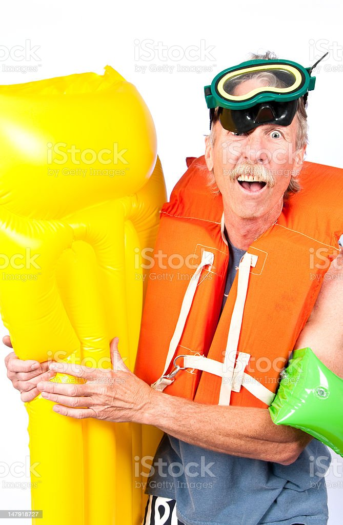 Senior man fed up with work, ready to swim stock photo