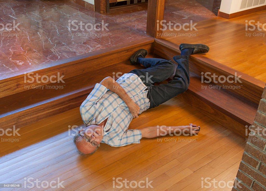 Senior man fell down the stairs stock photo
