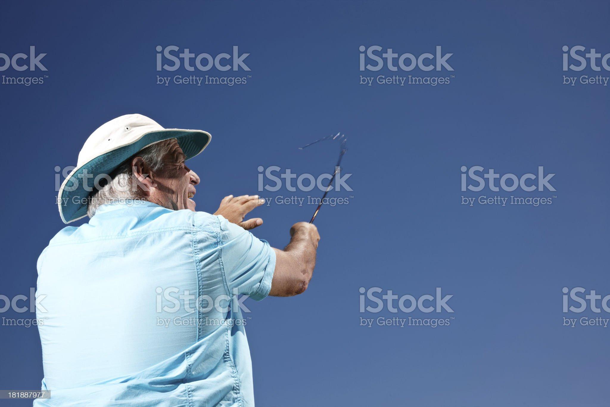 Senior man fishing royalty-free stock photo