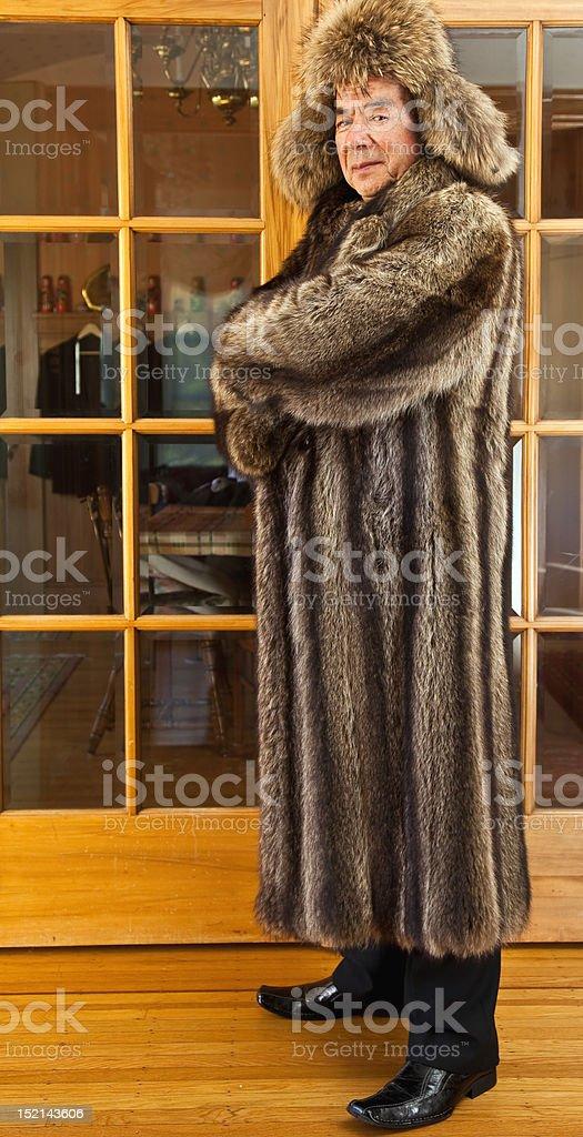 Senior man folk singer is wearing fur hat and  coat royalty-free stock photo