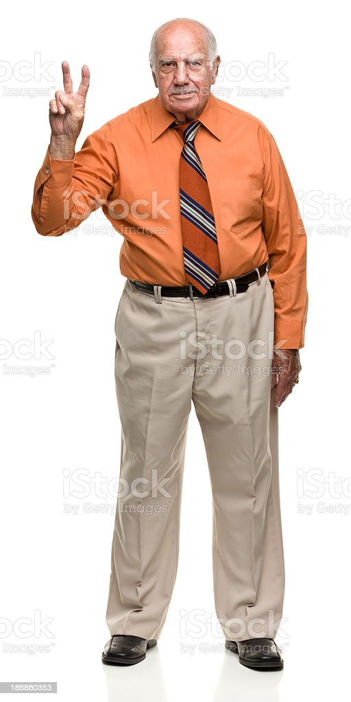 Senior Man Gives Peace Sign royalty-free stock photo