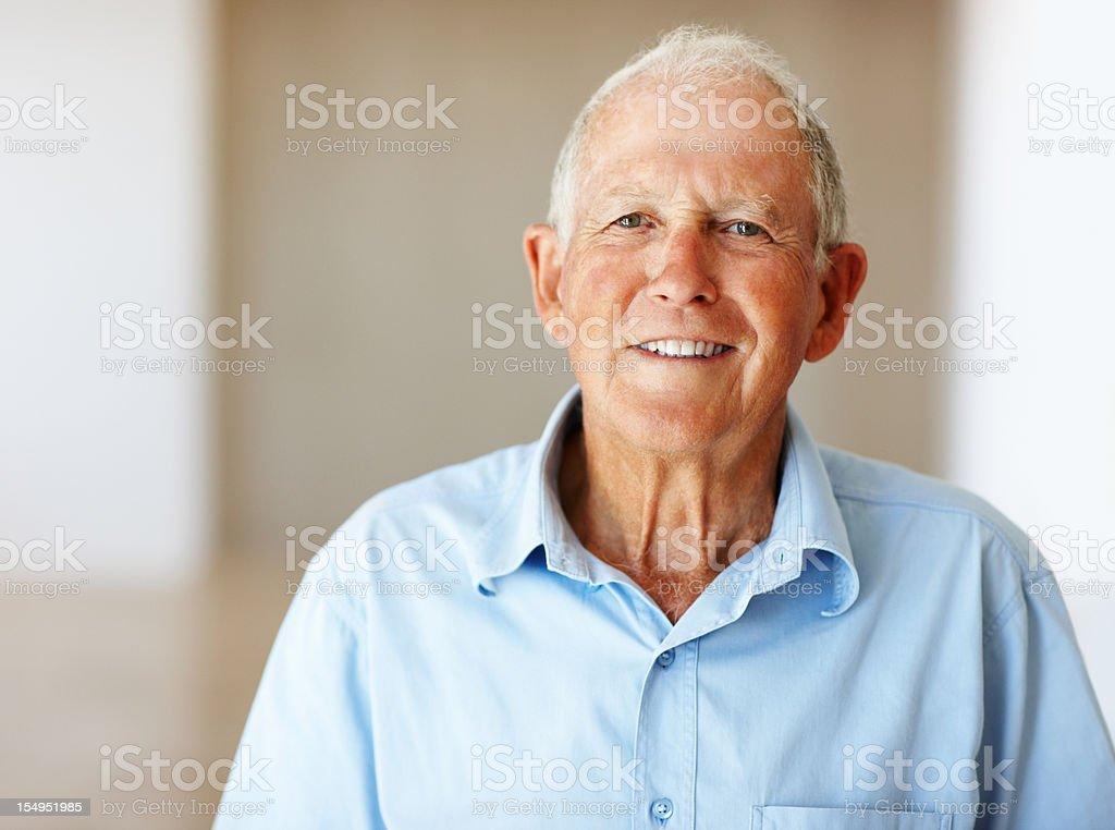 Senior man giving you a smile royalty-free stock photo