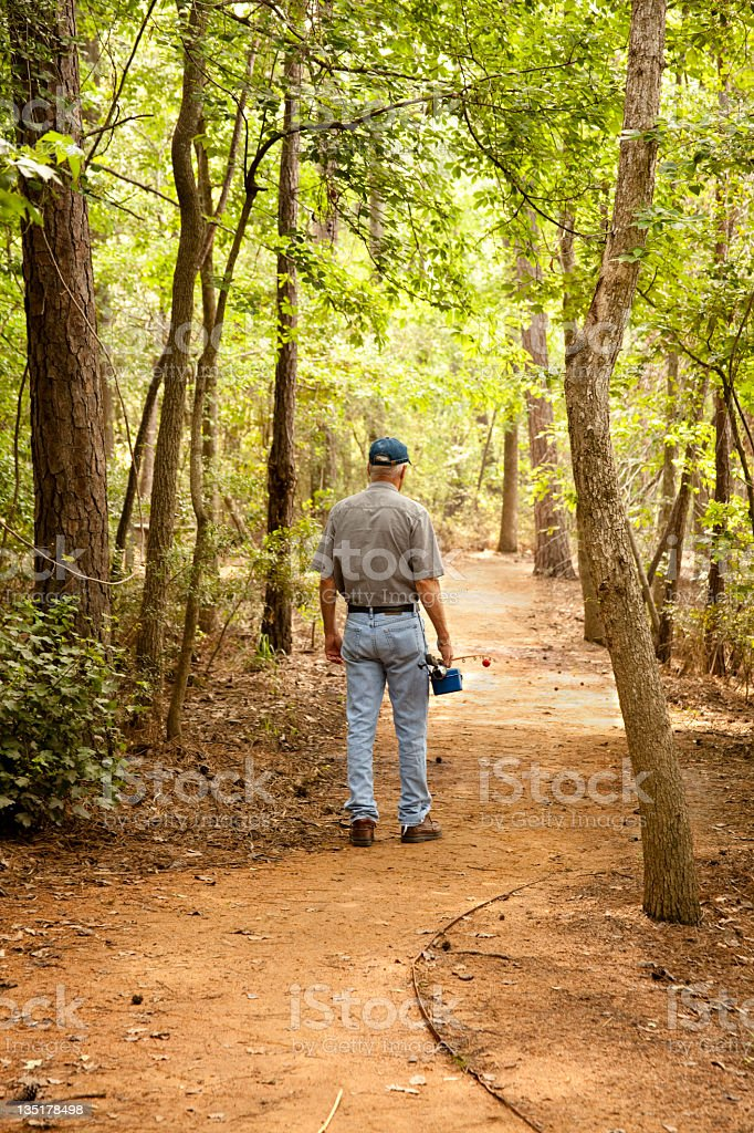 Senior man going fishing royalty-free stock photo
