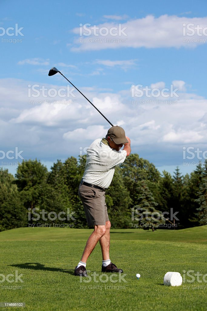 Senior Man Golf Player Playing on Golf Course royalty-free stock photo