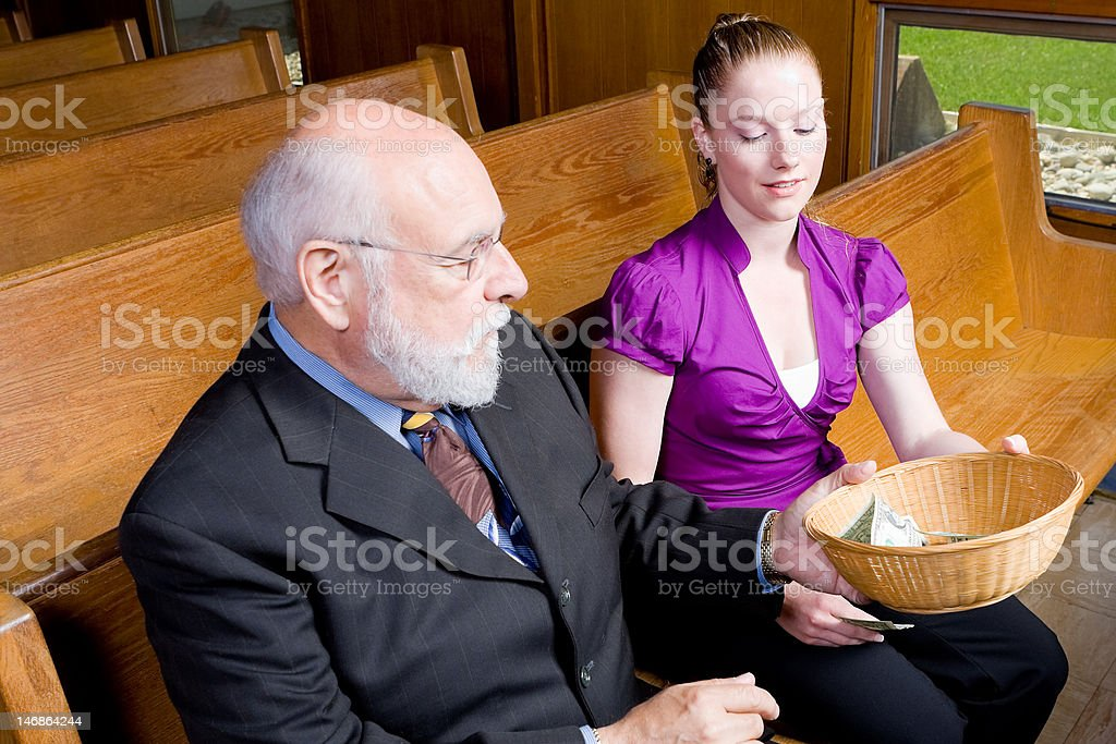 Senior Man Grandfather Passing Offering Basket Young Woman Church Pew stock photo