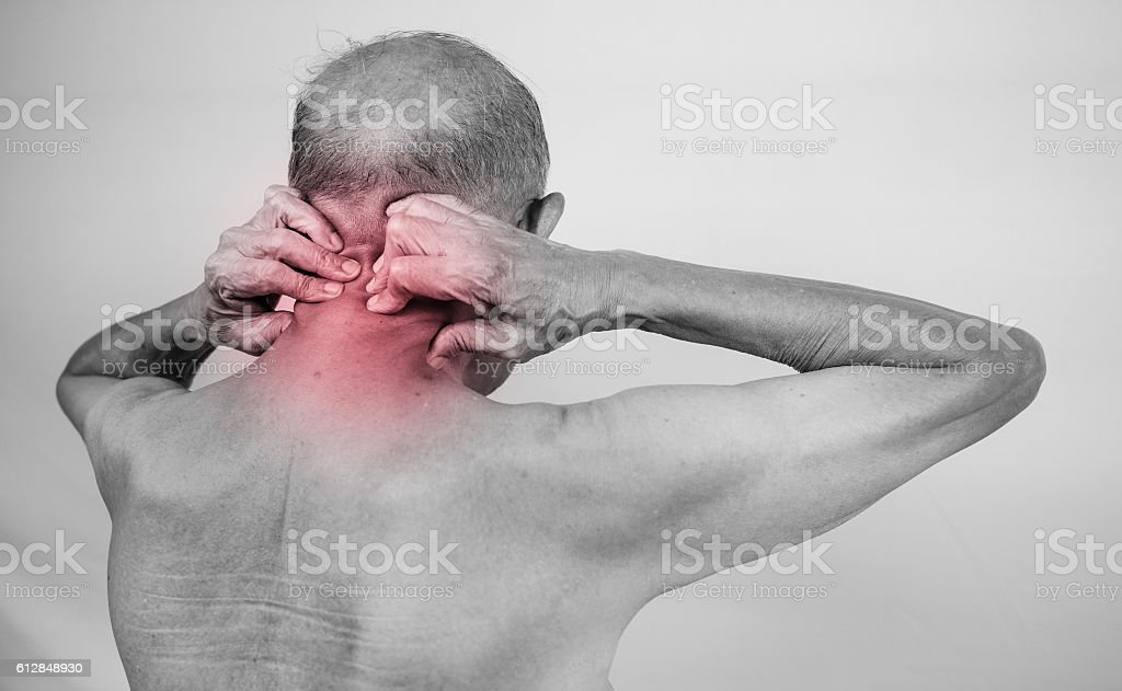 senior man hand holding he neck and massaging in pain area. Concept...