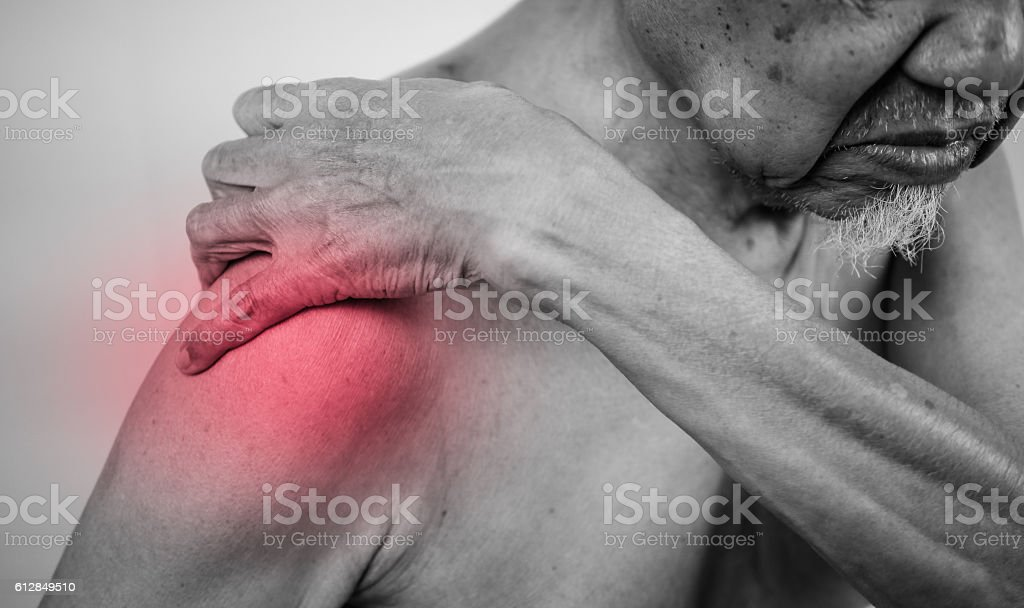 senior man hand holding healthy arm shoulder in pain area stock photo