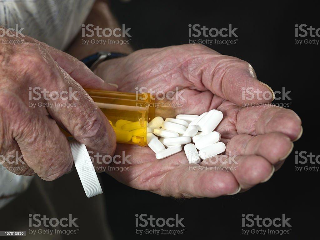 Senior man hands holding his prescription pills royalty-free stock photo