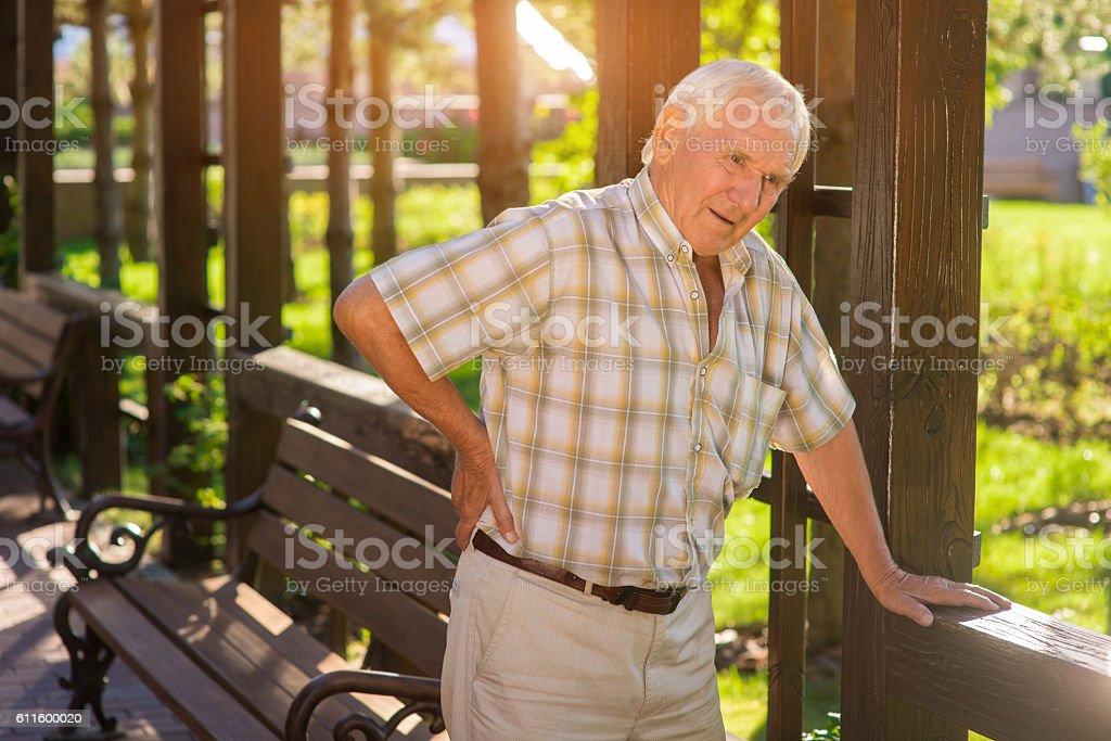 Senior man has backache. stock photo