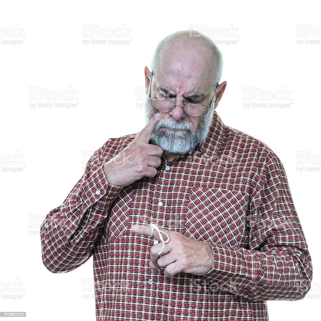 Senior Man Has Forgotten Why String Tied On Finger stock photo