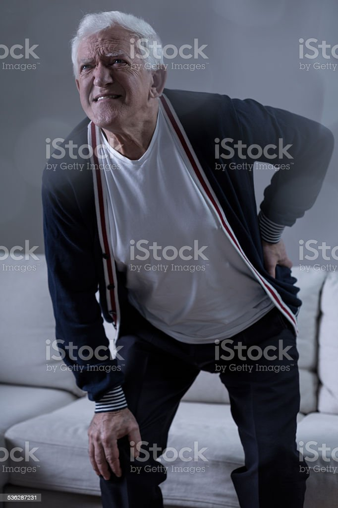 Senior man having back pain stock photo